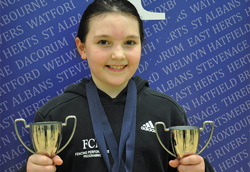 Young fencing star does the double
